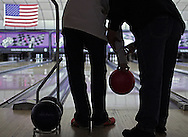 Michelle Shenberger of Dover, Pa. helps her visually impaired son, Raymond Grote, 16, bowl during the Eastgate Sunrise Lions Club's Bowl-A-Thon. Raymond took part in the event, which benefited For Sight Vision, along with other visually impaired bowlers, spouses and friends at Suburban Bowlerama on Sunday Jan. 21, 2010. / Photo by Bryant Hawkins for the York Dispatch