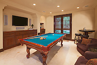 Billiards table in games room