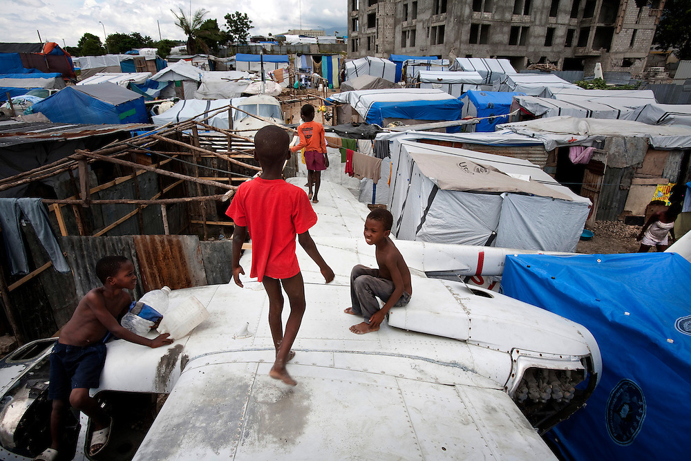 Daily life in the makeshift refugee camp, La Piste, in Port-au-Prince, Haiti on July 23, 2010. La Piste (French for &quot;runway&quot;)is a settlement sprawled across the site of a disused airport and now home to an estimated 20,000 earthquake survivors living in makeshift structures.<br /> Six month after a catastrophic earthquake measuring 7.3 on the Richter scale hit Haiti on January 13, 2010, killing an estimated 230,000 people, injuring an estimated 300,000 and making homeless an estimated 1,000,000.
