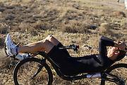 Sebastiaan Bowier van het Human Power Team Delft en Amsterdam is bezig met de warming up.  Het team, bestaande uit studenten van de TU Delft en de VU Amsterdam wil het record breken van 133 km/h. In Battle Mountain (Nevada) wordt ieder jaar de World Human Powered Speed Challenge gehouden. Tijdens deze wedstrijd wordt geprobeerd zo hard mogelijk te fietsen op pure menskracht. Ze halen snelheden tot 133 km/h. De deelnemers bestaan zowel uit teams van universiteiten als uit hobbyisten. Met de gestroomlijnde fietsen willen ze laten zien wat mogelijk is met menskracht. De speciale ligfietsen kunnen gezien worden als de Formule 1 van het fietsen. De kennis die wordt opgedaan wordt ook gebruikt om duurzaam vervoer verder te ontwikkelen.<br /> <br /> Sebastiaan Bowier of the Human Power Team Delft and Amsterdam is warming up. The team, with students of the TU Delft and de VU Amsterdam, wants to set a  new world record. In Battle Mountain (Nevada) each year the World Human Powered Speed Challenge is held. During this race they try to ride on pure manpower as hard as possible. Speeds up to 133 km/h are reached. The participants consist of both teams from universities and from hobbyists. With the sleek bikes they want to show what is possible with human power. The special recumbent bicycles can be seen as the Formula 1 of the bicycle. The knowledge gained is also used to develop sustainable transport.