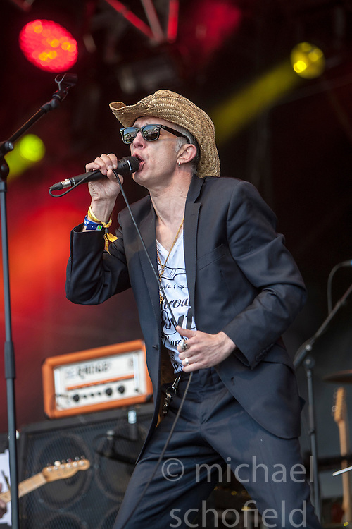 """Rob Spragg of Alabama 3 play the main stage. Sunday, Rockness 2013, the annual music festival which took place in Scotland at Clune Farm, Dores, on the banks of Loch Ness, near Inverness in the Scottish Highlands. The festival is known as """"the most beautiful festival in the world""""."""