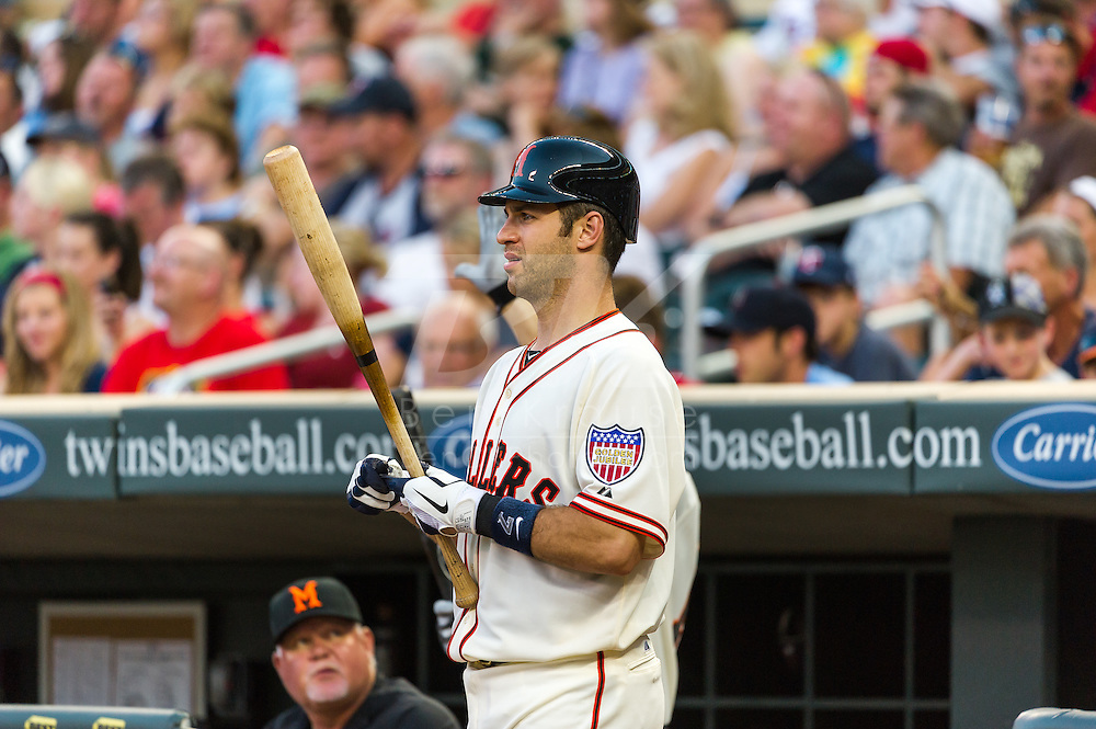 Wearing the 1951 uniform of the Minneapolis Millers,  Minnesota Twins catcher Joe Mauer prepares to bat against the Kansas City Royals at Target Field on June 30, 2012 in Minneapolis, Minnesota.  This was the second game of a split double header.  The Twins defeated the Royals 5 to 1. © 2012 Ben Krause