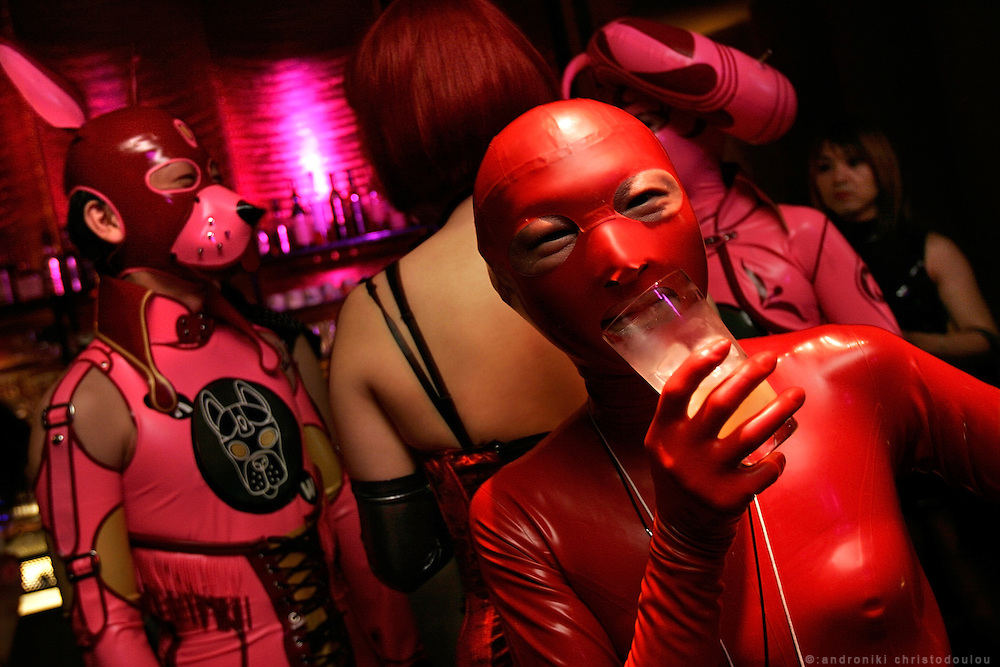 Rubber Brain party in club Mandala - Tokyo. .RUBBER BRAIN party is more about the fashion of dressing up in rubber (with a very strict dress code! you don't get in unless you are dressed up as something) and watching the shows which are quite artistic.