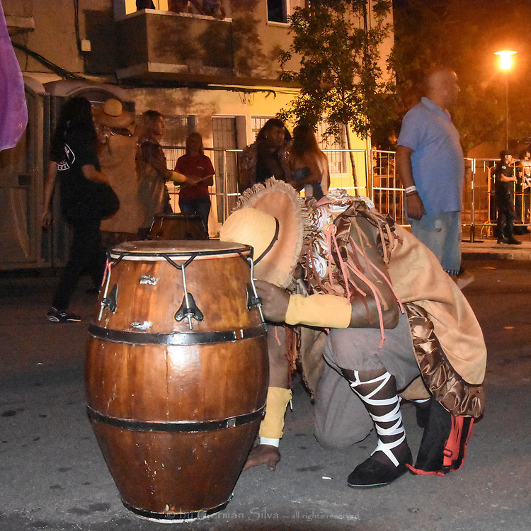 MONTEVIDEO, URUGUAY &ndash; February 2017:  &ldquo;Mas que lonja&rdquo; &ndash; more than just the leather of the drum head.  Preparation and parade for the 2017 &ldquo;Desfile de Llamadas&rdquo; or &ldquo;Parade of &lsquo;calls.&rsquo;&rdquo;   Preparation in the &lsquo;barrio&rsquo; Buceo.  Parade in barrios Sur (South) and Palermo.  February 10, 2017.  (Photo Copyrighted by German Silva).<br /> <br /> MONTEVIDEO, URUGUAY &ndash; Febrero 2017: &ldquo;Mas que lonja&rdquo; (mas que el cuero sobre o en el cual se toca el tambor).  Preparacion y &ldquo;desfile de Llamadas&rdquo; del Carnaval del Uruguay.  Preparacion en el barrio Buceo.  Desfile en los barrios Sur y Palermo, Montevideo, Uruguay.  Febrero 10 del 2017.  (Foto Copyrighted por German Silva).