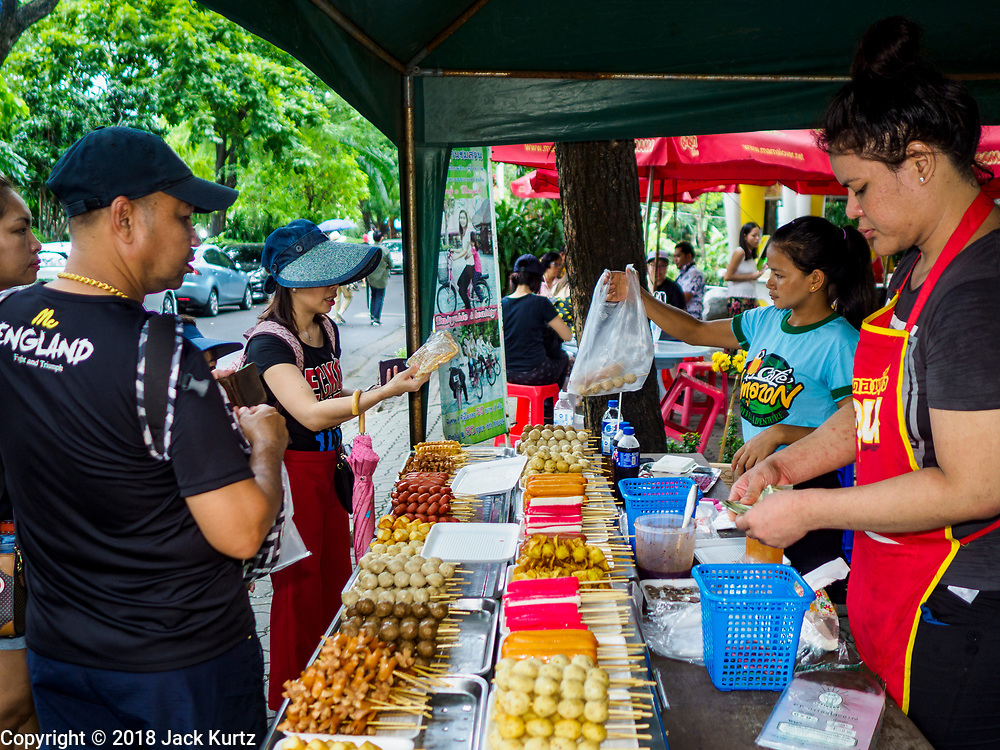 17 AUGUST 2018 - BANGKOK, THAILAND:   A vender sells grilled and fried meat on a stick at Dusit Zoo in Bangkok. The zoo opened in 1938. The zoo grounds were originally the Dusit Royal Garden. The zoo is scheduled to close by the end of August 2018 because it is being relocated to Nakhon Pathom province, south of Bangkok.     PHOTO BY JACK KURTZ
