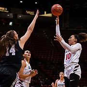 09 November 2018: San Diego State Aztecs guard Naje Murray (10) takes running jump shot over Hawaii Warriors center Lauren Rewers (14) in the first quarter. The Aztecs opened up it's regular season schedule with a 58-57 win over Hawaii Friday at Viejas Arena.