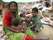 """Wails of """" Sob haraya galo"""" reverberates Kalapani .By Shib Shankar Chatterjee  .Dhubri, April 23: Heart wrenches as one reaches the tornado-hit villages in Kalapani. It seems as if hoards of wild Elephants trampled everything and anything that came across its way. Wails of """" Sob haraya galo"""" (everything is finished) rents the air.  .There was not a single house to be seen in all the six villages this correspondent visited today. Nandia, Patangitola, Dakin Bhorakati, Bengarbhaita, Toppara and Badia Beel resemble a single area with all men made landmarks uprooted by Mother Nature.  .31 people including 9 children were dead, 32 missing, 250 seriously injured and more than 10,000 have been left homeless in the wake of a powerful tornado that struck the region at around 7 pm and continued its destruction for almost 30 minutes on Tuesday evening. The dead includes 15 males and 16 females. There are reports of deaths of 30 domesticated animals also.   .Though casualty and damage reports remain incomplete, but the massive relief efforts by the district administration along with BSF have succeeded in regaining the confidence among the affected people. Deputy commissioner of Dhubri district, P Baruah visiting the tornado-ravaged areas and monitored the relief operation himself. Two relief camps have been organized for the affected people.     .Pics- SHIB SHANKAR CHATTERJEE..From : .SHIB SHANKAR CHATTERJEE,..A. C. Dasgupta Road, Ward Number - II,.Post Office & District - DHUBRI (Assam),.Pin Code Number - 783 301, (INDIA),.Phone Number -     +91-3662-231329 (R),.Fax     Number -     +91-3662-230076 (O),.Phone Number (Guwahati) -  +91-361-2474330 (P. P.),.E-mail Address - shibshankarc@rediffmail.com...    shibshankarc@yahoo.com...    shibshankarc@hotmail.com...    cshibshankar@sify.com. ."""