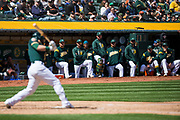The Oakland Athletics watch as a teammate hits against the San Francisco Giants at Oakland Coliseum in Oakland, California, on March 25, 2018. (Stan Olszewski/Special to S.F. Examiner)