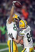 Green Bay Packers wide receiver Jeff Janis (83) celebrates with Green Bay Packers wide receiver Jared Abbrederis (84) after Janis catches a Hail Mary touchdown pass that ties the score at 20-20 with no time left on the game clock, sending the game into overtime during the NFL NFC Divisional round playoff football game against the Arizona Cardinals on Saturday, Jan. 16, 2016 in Glendale, Ariz. The Cardinals won the game in overtime 26-20. (©Paul Anthony Spinelli)