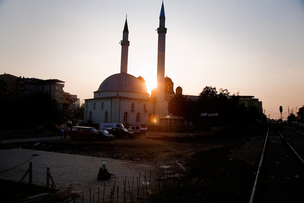 Street scene in Ferizaj, Kosovo. Mosque and Orthodox church standing side by side.