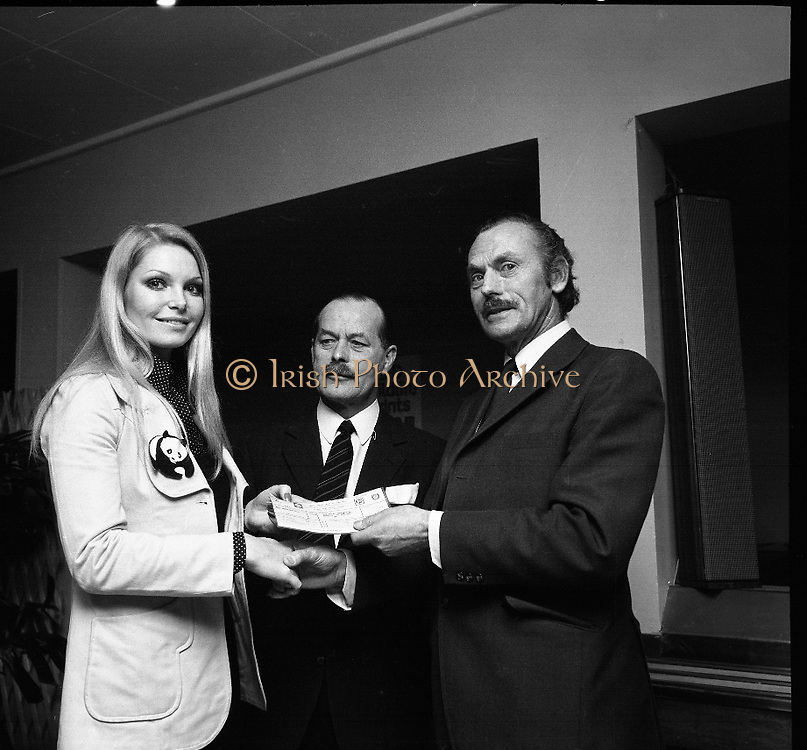 """Former Miss World Visits Dublin Zoo.<br /> 1973.<br /> 14.01.1973.<br /> 01.14.1973.<br /> 14th January 1973.<br /> Miss Eva Rueber-Staier, former Miss World from Austria and the """"World Wildlife Fund's Anniversary Girl"""", paid her first visit to Ireland to open the Shell/BP Irish Wildlife Promotion. As part of the promotion Eva paid a visit to Dublin Zoo in the Phoenix Park, Dublin.<br /> <br /> Image shows Miss Rueber-Staier presenting a cheque of £1000 to Mr Terry Murphy, The Director, Dublin Zoo. Included in the picture is Mr Herbert James, Operations Manager, Shell/BP who donated the cheque as part of the wildlife promotion."""