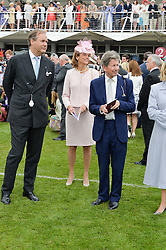 Left to right, the HON.HARRY HERBERT, LADY CAROLYN WARREN and JOHN WARREN at the Qatar Goodwood Festival - Ladies Day held at Goodwood Racecourse, West Sussex on 30th July 2015.