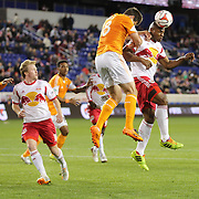 Jámison Olave, New York Red Bulls, heads goalwards while challenged by Kofi Sarkodie, Houston Dynamo, during the New York Red Bulls V Houston Dynamo, Major League Soccer regular season match at Red Bull Arena, Harrison, New Jersey. USA. 23rd April 2014. Photo Tim Clayton