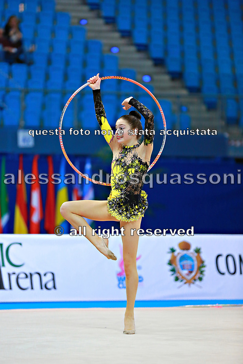 """Arbolishvili Ketevan during hooproutine at the International Tournament of rhythmic gymnastics """"Città di Pesaro"""", 01 April, 2016. Ketevan is an Azerbaijan individualistic gymnast, born in Tblisi, 2003.<br /> This tournament dedicated to the youngest athletes is at the same time of the World Cup."""