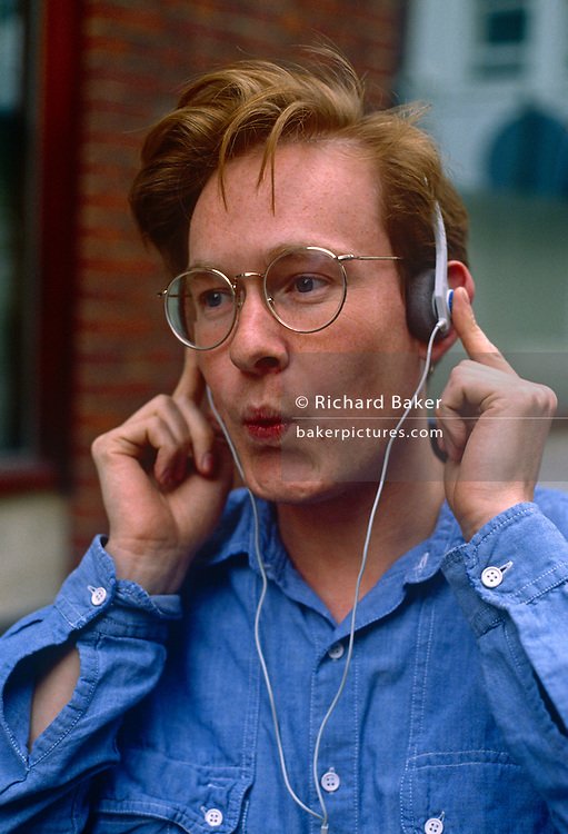 A young man whistles to a tune that he is listening to through headphones. It is 1989 and the Walkman is the toy of choice for the urban young - the first portable music device that helped change the way society took their taped music out and about - and years before the Apple iPod. It worked but one had to press the foam pads into the ears to drown out background city noise plus the cassette tape often snagged and twisted, ruining the product.