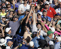 June 18, 2017 - Hartford, WI, USA - Fans clamor to reach a ball thrown by Charley Hoffman after he made a long putt on the 18th green during the final round of the 2017 U.S. Open Championship on Sunday, June 18, 2017 at Erin Hills in Hartford, Wis. (Credit Image: © Mike De Sisti/TNS via ZUMA Wire)