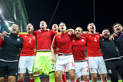 LILLE, FRANCE - Friday, July 1, 2016: Wales players celebrate in the team huddle following a 3-1 victory over Belgium and reaching the Semi-Final during the UEFA Euro 2016 Championship Quarter-Final match at the Stade Pierre Mauroy. head of performance Ryland Morgans, Chris Gunter, goalkeeper Daniel Ward, James Collins, David Edwards, David Vaughan, Ben Davies, equipment manager David Griffiths, Doctor Rhodri Martin. (Pic by David Rawcliffe/Propaganda)