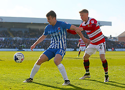 Hartlepool United's Rhys Oates (left) and Doncaster Rovers' Craig Alcock battle for the ball
