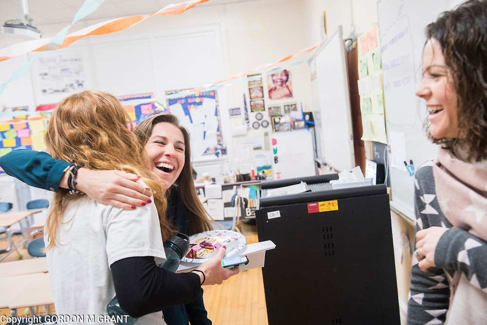 Cara Nelson, center, a seventh grade social studies teacher at East Hampton Middle School, greets fellow teachers Rita Greene, left, and Adrienne Posillico, right, upon returning from her recent trip that involved running seven marathons in seven days on seven continents, in East Hampton, Feb. 7, 2018. This was Nelson's first day back to school after finishing her last marathon on Monday in Miami.