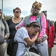 OXON HILL, MD-OCT20: Lakisha Jenkins, the mother of  Keyshaun Mason,14, who was stabbed to death by her live-in boyfriend, cries while her sister Jonisha Surles tries to comfort her, during a press conference outside Potomac High School in Oxon Hill, MD, October 20, 2105. During a domestic dispute, Lakisha Jenkins, was barricaded in the master bedroom of her home by her live-in boyfriend, 48-year-old Sean Crawford. Crawford was armed with a kitchen knife. Keyshaun Mason, 14, and his 18-year-old brother attempted to enter the master bedroom to ask Crawford to leave their home. According to the documents, Crawford then stabbed Keyshaun in the chest. Both teens were taken to a local hospital where Keyshaun was pronounced dead. His brother was treated at the hospital and released. (Photo by Evelyn Hockstein/For The Washington Post)