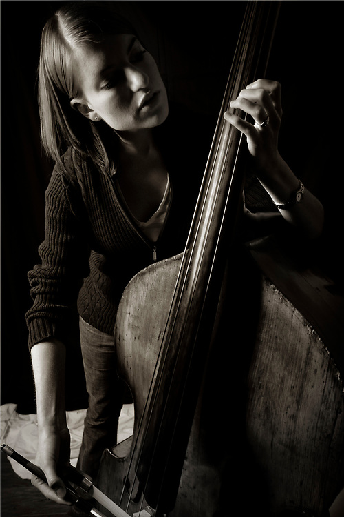 Colleen takes upright bass lessons from Tim after a photo shoot in Scott's Big X Studio.<br /> <br /> (&copy;2010 Mark Dawson)