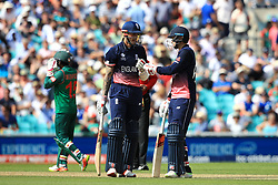England's Alex Hales (left) touches gloves with teammate Joe Root during the ICC Champions Trophy, Group A match at The Oval, London.