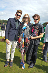 Left to right, HENRY HOLLAND, LAURA CARMICHAEL and CHRISTOPHER KANE at the 2012 Veuve Clicquot Gold Cup Final at Cowdray Park, Midhurst, West Sussex on 15th July 2012.