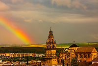 The Mezquita (the Mosque-Cathedral) of Corboba with a rainbow behind it, Cordoba Province,  Spain.
