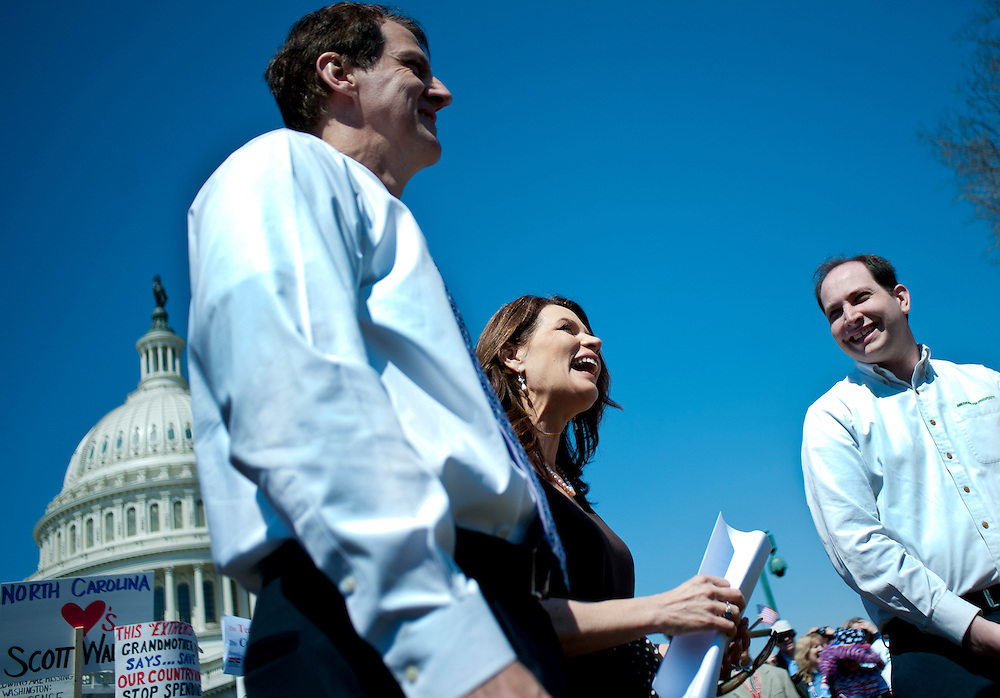 "Rep. MICHELE BACHMANN (R-MN) looks on before speaking to the crowd during a rally near the U.S. Capitol. The ""Cut Spending Now Revolt"", staged Americans for Prosperity, was held to urge lawmakers to reduce federal spending. Americans for Prosperity describes itself as the nation's leading free-market, grassroots organization."
