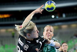 Susann Mueller of Krim vs Heidi Loke of Gyori  during handball match between RK Krim Mercator and Gyori Audi ETO KC (HUN) in 3rd Round of Group B of EHF Women's Champions League 2012/13 on October 28, 2012 in Arena Stozice, Ljubljana, Slovenia. (Photo By Vid Ponikvar / Sportida)