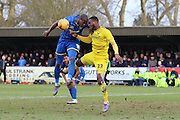 Tom Elliott of AFC Wimbledon and Chey Dunkley of Oxford United FC battle for the high ball during the Sky Bet League 2 match between AFC Wimbledon and Oxford United at the Cherry Red Records Stadium, Kingston, England on 27 February 2016. Photo by Stuart Butcher.