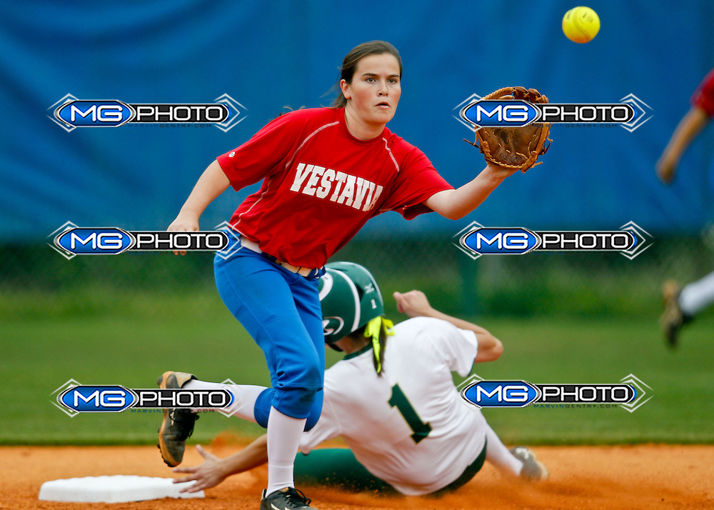Mountain Brook Spartans and Vestavia Hills Rebels play softball at Vestavia home field. Vestavia defeated Mountain Brook 7-2. Thursday, April 17, 2014. Marvin Gentry