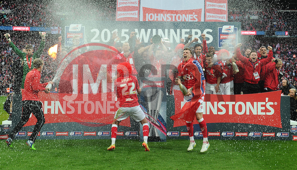 Bristol City Players celebrate with the JPT Trophy and champagne  - Photo mandatory by-line: Joe Meredith/JMP - Mobile: 07966 386802 - 22/03/2015 - SPORT - Football - London - Wembley Stadium - Bristol City v Walsall - Johnstone Paint Trophy Final
