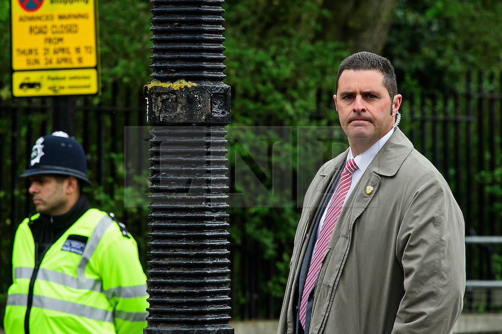 © London News Pictures. 22/04/2016. London, UK. A member of the secret service (right) stands on guard at the entrance to the secure area of Regents Park. Heightened security surrounding the residence of the US Ambassador to the United Kingdom in Regents Park, London, where the President of the United States Barak Obama is staying during his visit to the UK. Photo credit: Ben Cawthra/LNP