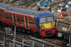 © Licensed to London News Pictures. 15/08/2017. London, UK. A derailed train rests on the wagons of a freight train at Waterloo station in London after a low speed collision. People have been advised to avoid using Waterloo station, which is undergoing major development works, for the remainder of the day.  Photo credit: Peter Macdiarmid/LNP