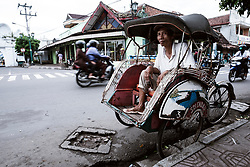Bekaks are plentiful in Yogyakarta, this rider waits for some passengers