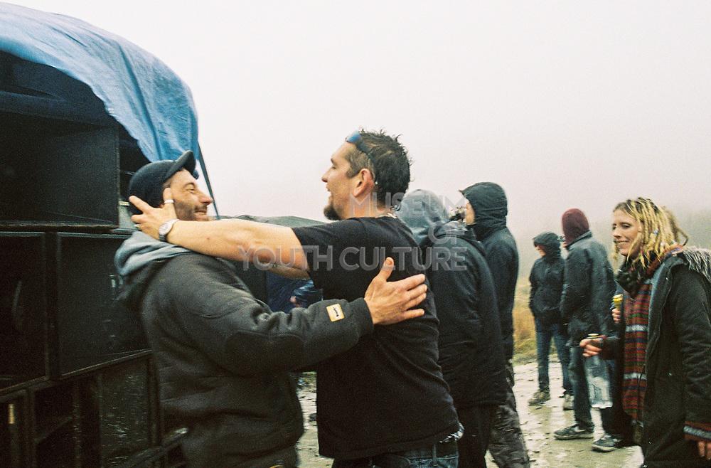Men hug at MUDTREK, Llanddewi Brefi, Wales 2016