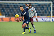 Eamonn Brophy (#9) of Kilmarnock FC shields the ball from Clevid Dikamona (#28) of Heart of Midlothian FC during the Ladbrokes Scottish Premiership match between Kilmarnock FC and Heart of Midlothian FC at Rugby Park, Kilmarnock, Scotland on 23 November 2019.
