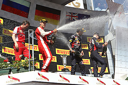 26.07.2015, Hungaroring, Budapest, HUN, FIA, Formel 1, Grand Prix von Ungarn, Rennen, im Bild Sektdusche auf dem Podium, Sebastian Vettel (Scuderia Ferrari), Daniel Ricciardo (Infiniti Red Bull Racing/Renault), Daniil Kwjat (Infiniti Red Bull Racing/Renault) // during the race of the Hungarian Formula One Grand Prix at the Hungaroring in Budapest, Hungary on 2015/07/26. EXPA Pictures &copy; 2015, PhotoCredit: EXPA/ Eibner-Pressefoto/ Bermel<br /> <br /> *****ATTENTION - OUT of GER*****