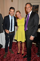 Left to right, DOMINIC COOPER, CHRISTINE SIEG and ANDRE KONSBRUCK at the Audi Ballet Evening at The Royal Opera House, Covent Garden, London on 23rd April 2015.