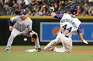 PHOENIX, AZ - APRIL 27:  Paul Goldschmidt #44 of the Arizona Diamondbacks safely steals second base in front of Ryan Schimpf #11 of the San Diego Padres during the fourth inning at Chase Field on April 27, 2017 in Phoenix, Arizona.  (Photo by Jennifer Stewart/Getty Images)