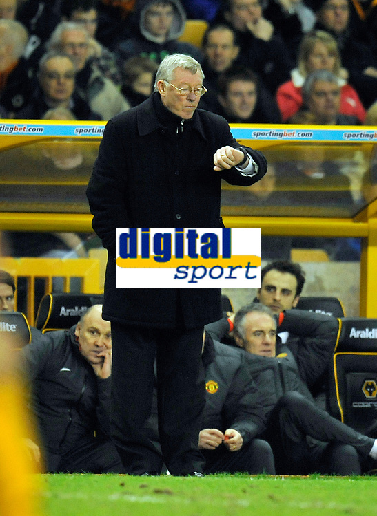 Molineux Grounds Wolverhampton Wanderers v Manchester United (2-1)  Premier League 05/02/2011<br />Manchester United Manager Sir Alex Ferguson checks his watch, but despite five minutes added time, United lose their 29 match unbeaten run<br />Photo: Roger Parker Fotosports International
