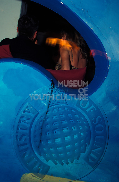 A man and woman sit down in Ministry of Sound Nightclub, London, U.K.