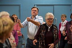 © London News Pictures. 01/05/2015. Shadow Chancellor ED BALLS taking part in a line dancing session during a visit to Kingsgate Community Centre in Kilburn, North London to campaign in the 2015 general election. Photo credit: Ben Cawthra/LNP
