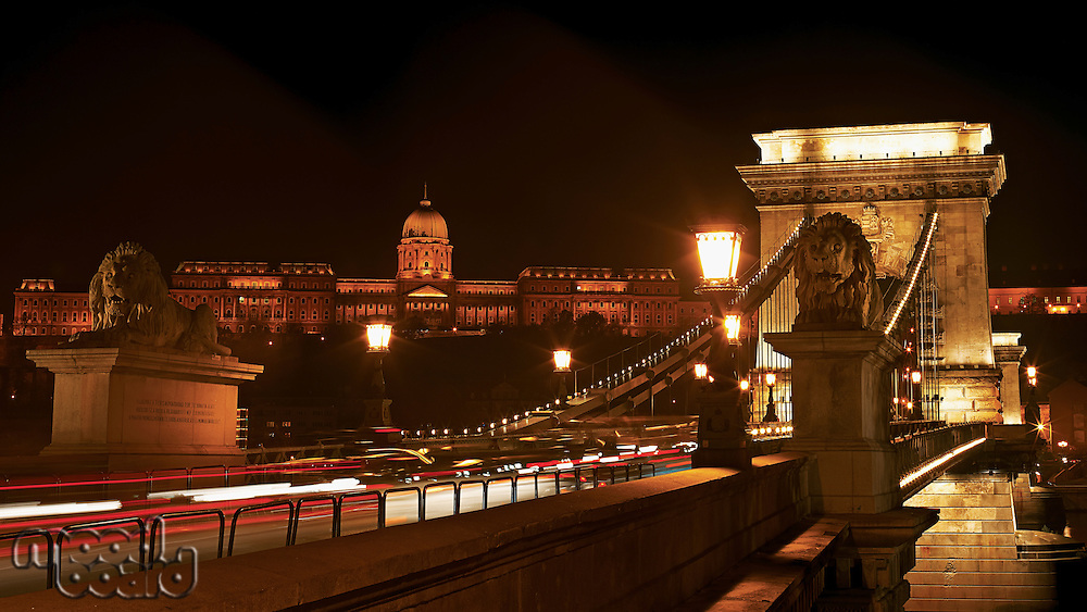 Night cityscape of the Chain bridge across the river Danube with the Buda castle in the background in the Hungarian capital  Budapest