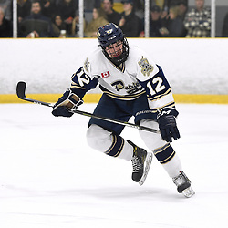 TORONTO, ON  - APR 10,  2018: Ontario Junior Hockey League, South West Conference Championship Series. Game seven of the best of seven series between Georgetown Raiders and the Toronto Patriots. Adam Petric #12 of the Toronto Patriots pursues the play during the first period.<br /> (Photo by Andy Corneau / OJHL Images)
