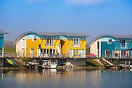 NLD, the Netherlands, Gelderland, Maasbommel, flood protected amphibian homes at the river Meuse [the cellar of the houses is a waterproofed, floatable tub made of concrete, which lifts the buildings with the rising waters, the houses can rise up to 5,5 meters with the water level, they are mounted at two steel pylons to prevent them against leeways].<br /> <br /> NLD, Niederlande, Gelderland, Maasbommel, hochwassersichere Amphibienhaeuser an der Maas [der Keller der Haeuser ist eine wasserdichte, schwimmfaehige Wanne aus Beton, die bei steigendem Wasser fuer genuegend Auftrieb sorgt, die Haeuser koennen bis zu 5,5 Meter mit dem Wasserspiegel der Fluten steigen, sie sind an zwei Stahlpylonen gegen das Abdriften gesichert].