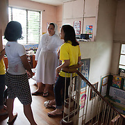 A sisters who lives with the girls in the home chat and talk about laughter - who laughs how in the home - which the all laugh about. The Laura Vicuña Centre in Cubao houses 30 street girls who may be orphaned, neglected, abandoned, battered, morally endangered and sexually abused. Laura Vicuña is a non-profit charity working in Manila and in Bacolod in the state Negros Occidental in the Philippines.
