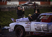 After finishing her race for the night Chelsey O'Reilly, 14, puts on makeup while talking with her mother, Margaret, in the pits of Agassiz Speedway in Agassiz, BC (2012)