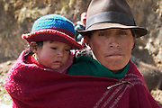 Ermelinda Ayme Sichigalo carries Orlando Jr. on her back on the way to the weekly market in Simiatug, Ecuador.  /// The Ayme family of Tingo, Ecuador, a village in the central Andes, is one of the thirty families featured, with a weeks' worth of food, in the book Hungry Planet: What the World Eats. The family consists of Ermelinda Ayme Sichigalo, 37, Orlando Ayme, 35, and their children: Livia, 15, Moises, 11, Jessica, 10, Natalie, 8, Alvarito, 4, Mauricio, 30 months, and Orlando hijo (Junior), 9 months. Lucia, 5, lives with her grandparents to help them out. (Please refer to Hungry Planet book p. 106-107 for a family portrait [Image number ECU04.0001.xxf1rw] including a weeks' worth of food, and the family's detailed food list with total cost.) Ermelinda Ayme is also one of the 80 people featured with one day's food in the book What I Eat: Around the World in 80 Diets. MODEL RELEASED.